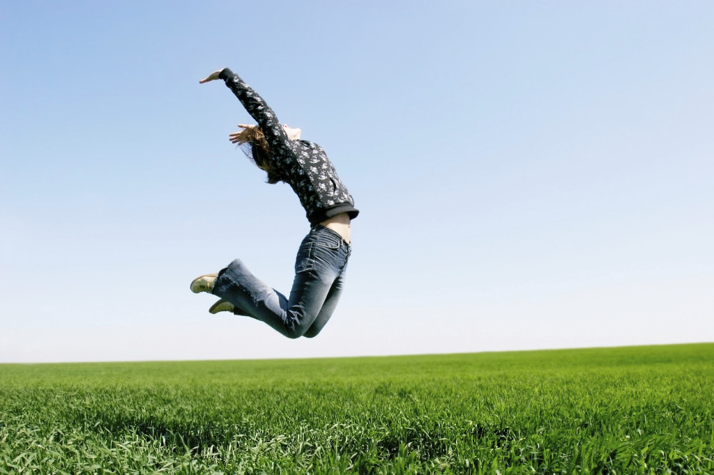 happy girl jumping on natural background